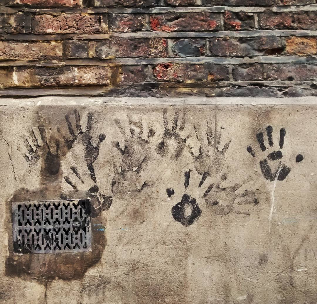 Saturday afternoon in #soho.  This little #graffiti caught my eye,  rule of thirds was written all over it.  #london #palms #hands #wall